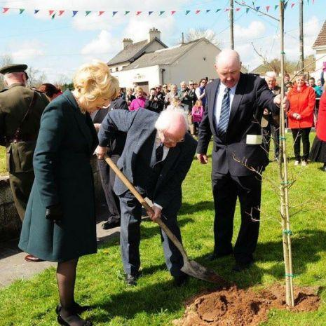 President Michael D Higgins planting a tree