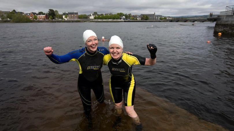 Roisin Quin, Limerick and Emma Kelly, Limerick complete the fun social swim in the majestic Shannon from the historic Curraghour Boat Club as part of Riverfest Limerick 2018. Photo: Sean Curtin True Media