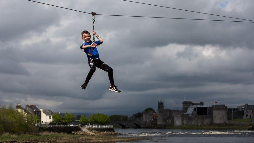 James McMahon Ennis, Clare on the zip line across the Shannon at Limerick Riverfest 2018. Photo: Sean Curtin True Media.