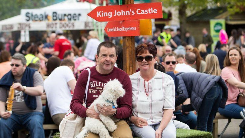 Pat and Dawn Donnelly, Ballyneety with their dog Sam at the 2018 Riverfestival Village at Arthurs Quay Park, Limerick. Photo: Sean Curtin True Media.