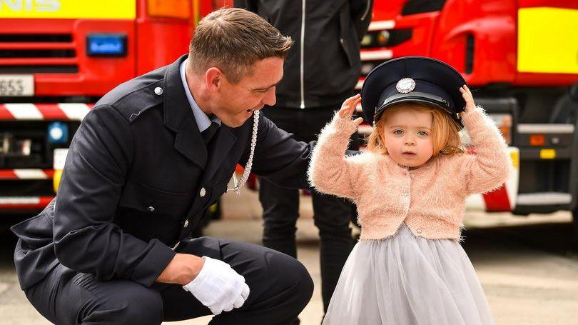 Limerick Firefighter Tarlach Kelly with his 2-year-old daughter. Pic Diarmuid Greene 540x460